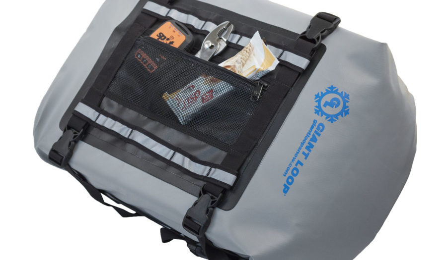 waterproof snowmobile tunnel bag features mesh pocket for tools and wet gear