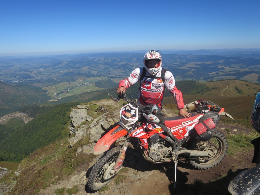Beta Polska: Beta motorcycle on mountain top in Poland with Giant Loop's MoJavi Saddlebag, Fandango Tank Bag and Pronghorn Straps