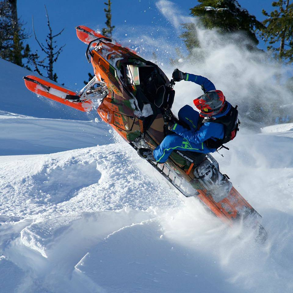 Snowmobile with Giant Loop Snow waterproof tunnel bag and gear
