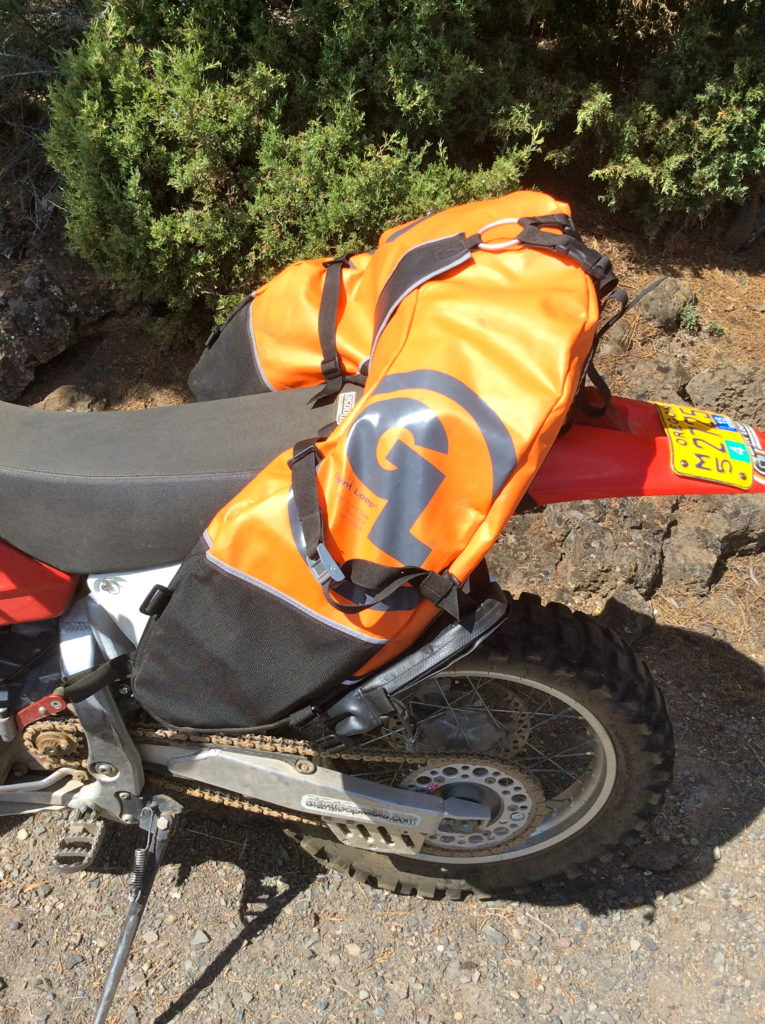 Keep your extra fuel weight, low, tight and balanced with the Reda can inside the Coyote Saddlebag