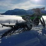 Rory Sullivan's Timbersled snow bike above the clouds with Gas Bag Fuel Safe Bladder on tunnel