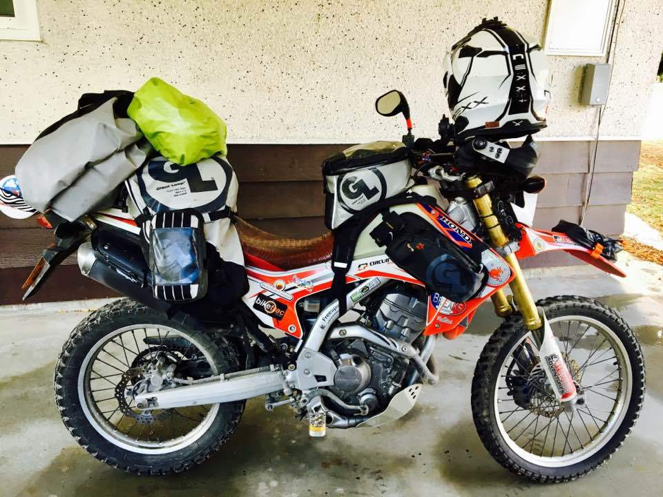 Giant Loop Rider Steph-Jeavons's Honda CRF250L packed for 'round the world adventure with Giant Loop's adventure proof packing systems and gear.