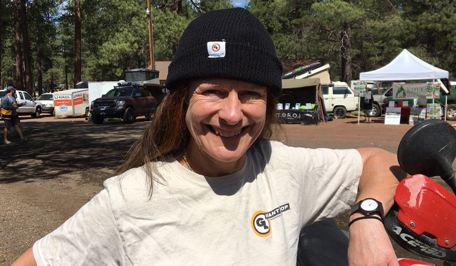 Tiffany Coates, woman adventure motorcycle legend, with Giant Loop beanie and t-shirt