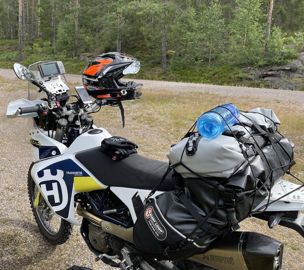 Coyote Saddlebag and Rogue Dry Bag on a Husqvarna