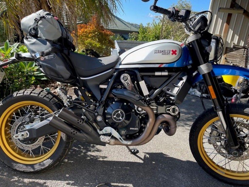 MoJavi Saddlebag and Rogue Dry Bag on his Ducati Desert Sled